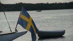 Slender and elegant yacht sails to port in Stockholm archipelago. Stock Footage