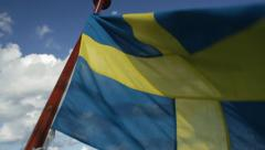 Swedish Flag blows in wind on back of boat. Stock Footage