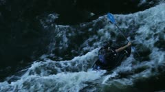 Canoeist on fast water at nightfall on Stockholm channel Stock Footage