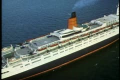 QE2 aerial, ship at sea, pass over, wide shot Stock Footage