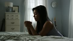 Young woman praying Stock Footage