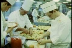 QE2, Queen Elizabeth 2, ship galley kitchen, medium shot Stock Footage