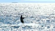 Stock Video Footage of Kiter on glittering sea