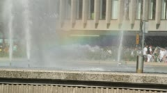 Rainbow in mist of fountain at Sergelstorg, Stockholm. Stock Footage