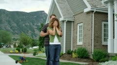 husband surprising wife with a new house - stock footage