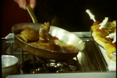 QE2 Princess Grill, head waiter prepares duck at trolley, close up in pan - stock footage