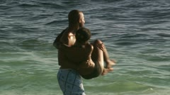 Couple embracing at the beach Stock Footage