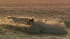 Males surfing Stock Footage