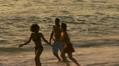 Two couples playing at beach Stock Footage