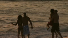 Two couples playing in the water at the beach Stock Footage