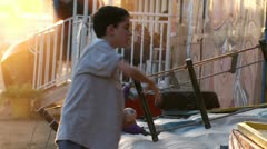 Boy winning game at fairgrounds Stock Footage