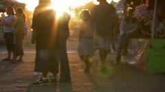 Slow speed view of crowd at fairground - stock footage