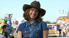 Woman posing with cowboy hat Stock Footage