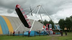 The big ship swing in Russian amusement park Stock Footage