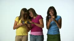 Tween girls with cell phones Stock Footage