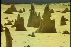 The Pinnacles, Western Australia, limestone formations in sandy desert, backlit Stock Footage