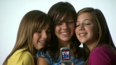 Three tweens with cell phones Stock Footage