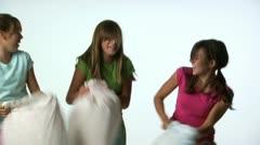 Tween girls pillow fighting Stock Footage