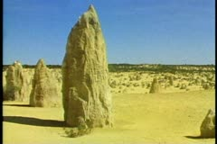 The Pinnacles, Western Australia, limestone formations in sandy desert Stock Footage