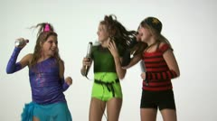 Teenage girls dancing and singing into curling iron and hairbrush Stock Footage