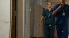 Doctor and nurses running in hospital corridor Stock Footage