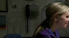 Female technician discussing ultrasound with pregnant female patient - stock footage