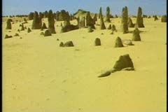 The Pinnacles, Western Australia, limestone formations in sandy desert, Stock Footage