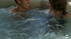 A couple in a hot tub Stock Footage