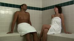 A couple in towels relaxing Stock Footage