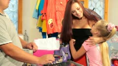Buying Children's Shoes in Shoe Store - stock footage