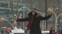 A woman having fun skating at an ice rink Stock Footage