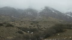 Cloudy panoramic view of mountains Stock Footage