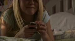 A young woman listening to her iPod Stock Footage