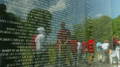 Time lapsed people's reflections in a monument plaque - stock footage