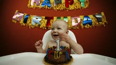 Time lapse of a baby eating their first birthday cake - stock footage