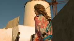 A woman in sunglasses going up stairs in Mykonos Stock Footage