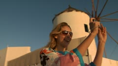 A woman taking a picture in Mykonos Stock Footage