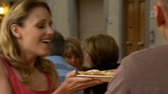 A woman being served outdoors at a restaurant Stock Footage