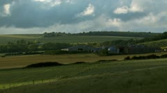 Time lapsed view of a large farm on a scenic hillside Stock Footage
