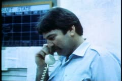 The Royal Flying Doctors Service, male doctor on phone, Alice Springs, Australia Stock Footage