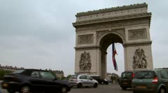Slow pan of cars passing the Arc de Triomphe - stock footage