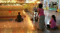 Visitors in Chauk Htatt Ghyee Pagoda Stock Footage