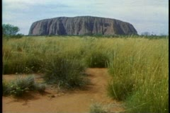 Ayres Rock, the Outback of Australia, wide shot, classic, magic hour light Stock Footage