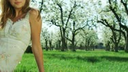 Woman sitting in an orchard Stock Footage