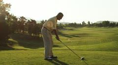 Senior golfer teeing off Stock Footage