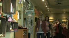 Two women shopping for baby clothing Stock Footage