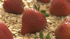 Strawberries on a bed of oats Stock Footage