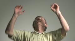 Man catching money falling from the sky Stock Footage