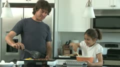 Family making breakfast in the kitchen Stock Footage