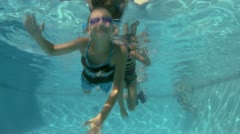 Children in a swimming pool Stock Footage